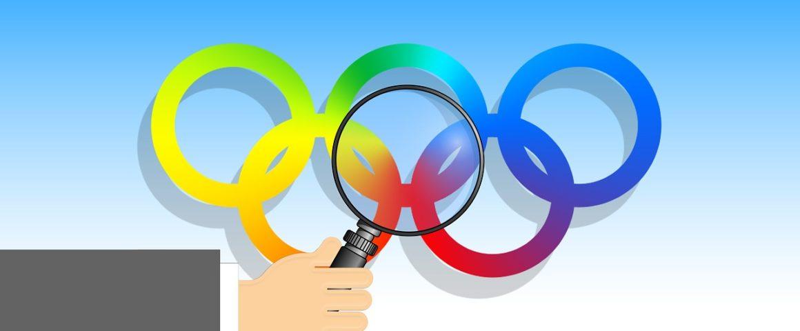 Olympische Ringe uner einer Lupe