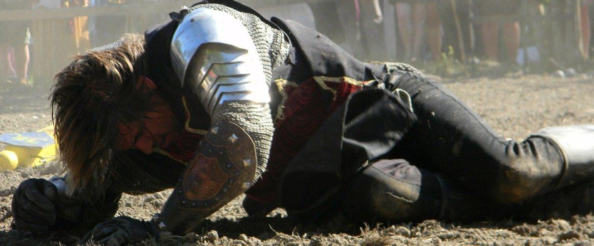 Ritter, geschlagen am Boden liegend